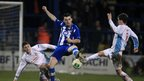 Davy Munster and Gavin Taggart challenge Coleraine's Michael Hegarty