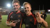 Dragons players celebrate beating Cardiff Blues