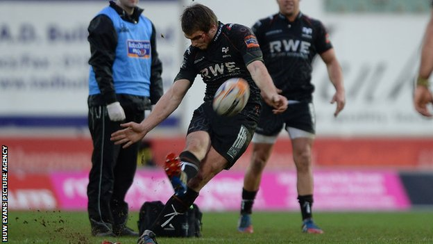 Ospreys fly-half Dan Biggar kicks at goal in the Boxing Day match against Scarlets