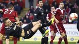 Shaun Hutchinson (below left) challenges for the ball with Aberdeen's Michael Hector
