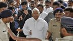 Rashtriya Janata Dal (RJD) Chief and a former Bihar Chief Minister Lalu Prasad Yadav (C) arrives at a court in the eastern Indian city of Ranchi September 30, 2013