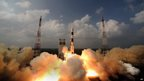 This handout photograph released by the Indian Space Research Organisation (ISRO) on November 6, 2013, shows the PSLV-C25 rocket carrying the Mars Orbiter Spacecraft blasting off from the launch pad at Sriharikota on November 5, 2013. I