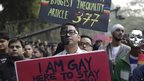 Gay rights activists hold placards during a protest against a Supreme Court verdict that upheld section 377 of the Indian Penal Code that criminalizes homosexuality, in New Delhi, India, Sunday, Dec. 15, 2013.