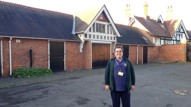 Pigeon historian Colin Hill outside the Bletchley Park pigeon lofts