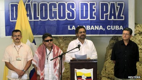 FARC lead negotiator Ivan Marquez makes an announcement while flanked by fellow negotiators Pablo Catatumbo (right), Jesus Santrich (second left and Yuri Camargo (left) in Havana on 8 December, 2013