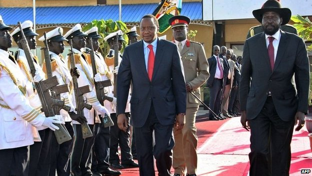South Sudanese President Salva Kiir (R) and Kenyan President Uhuru Kenyatta (C) reviewing an honour guard during a visit to Juba.