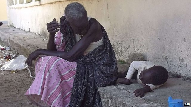 A South Sudanese woman with a child in Bor