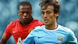 Manchester United's Patrice Evra and Manchester City's David Silva
