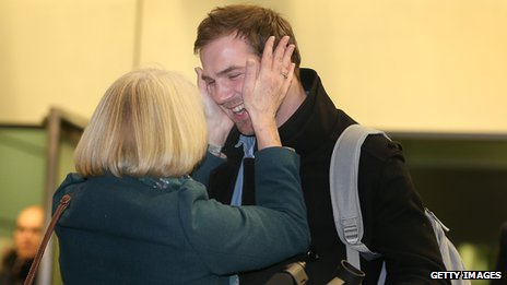 Kieron Bryan is held by his mother, Ann