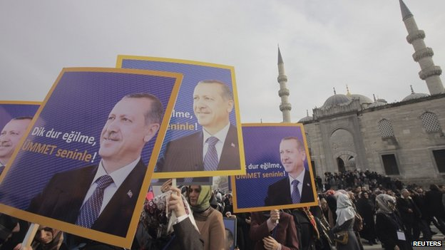 "Supporters of the ruling AK Party hold posters of Turkey""s Prime Minister Tayyip Erdogan during a demonstration in support him in Istanbul December 27, 2013"