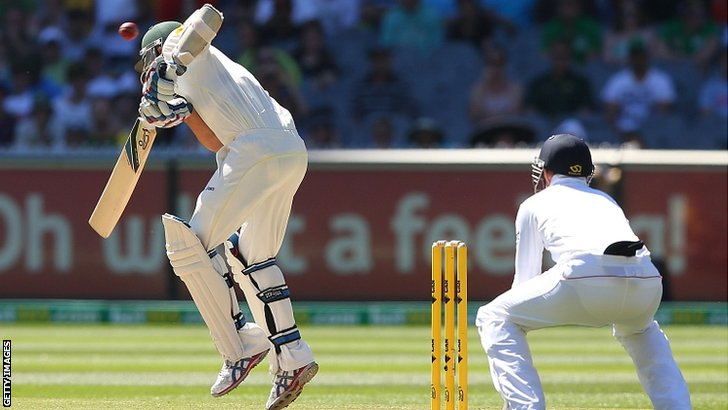Nathan Lyon of Australia ducks a bouncer from Stuart Broad