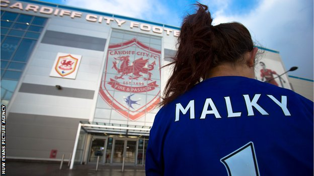 Cardiff supporter outside the Cardiff City Stadium