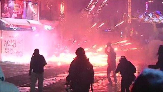 Protestors throwing fireworks