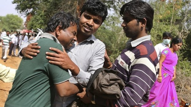 A survivor of the train fire near Kothacheruvu, Andhra Pradesh state, India, mourns family lost in the blaze on Saturday