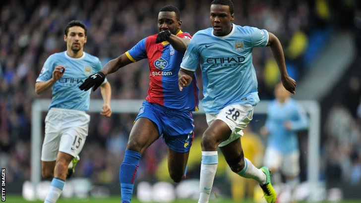 Dedryck Boyata of Manchester City (right) competes with Yannick Bolasie of Crystal Palace