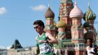 Paul Pollock runs past St Basil's Cathedral in Moscow