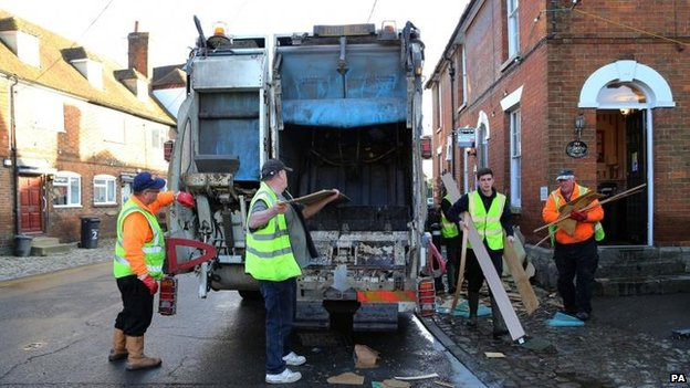 Workmen clear debris from homes in Yalding, Kent, after it was flooded during the recent bad weather.