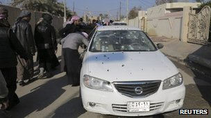 Bullet-ridden car outside the home of Iraqi Sunni MP Ahmed al-Alwani, Ramadi (28 December)