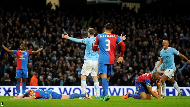 Edin Dzeko celebrates scoring for Manchester City