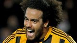 Tom Huddlestone celebrates scoring against Fulham