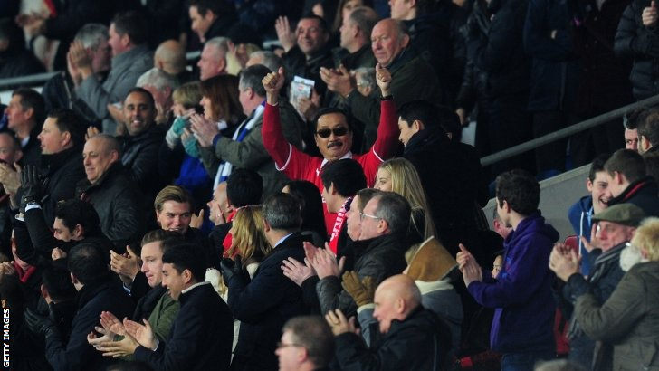 Cardiff owner Vincent Tan celebrates his team scoring