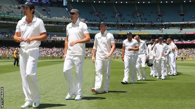 Alastair Cook leads his team from the field after their eight-wicket humiliation n Melbourne