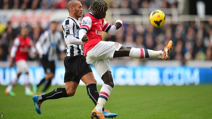 Newcastle United's Yoan Gouffran (left) and Arsenal's Bacary Sagna