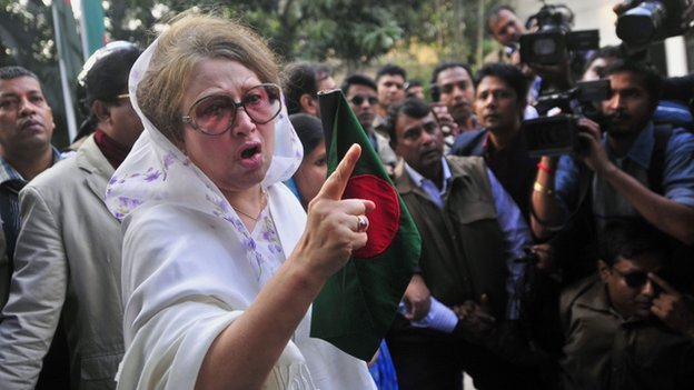 "Bangladesh""s former Prime Minister and main opposition Bangladesh Nationalist Party (BNP) leader Khaleda Zia gestures as she walks out of her home in Dhaka, Bangladesh, Sunday, Dec. 29, 2013"