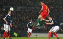 Hal Robson Kany scored Wales' winner at a snowy Hampden Park to secure a World Cup qualifying win over Scotland.