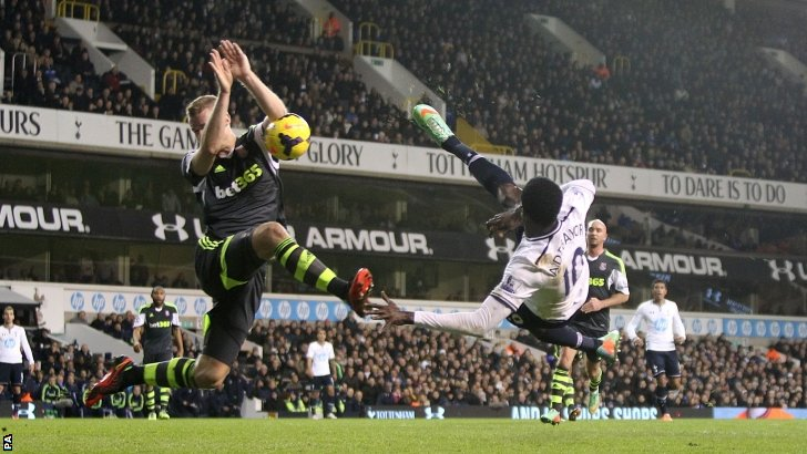Emmanuel Adebayor (right) sees an effort at goal blocked