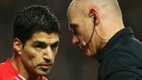 Liverpool striker Luis Suarez and referee Howard Webb