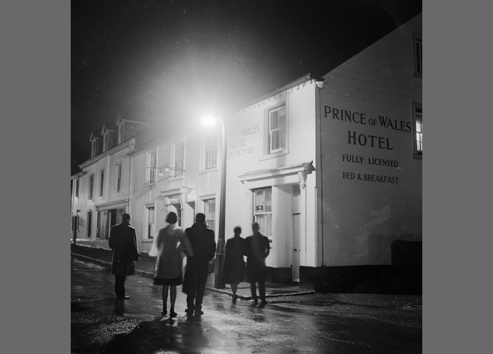 Teenagers make their way to a youth club upstairs at the Prince of Wales Hotel in Princetown, Dartmoor, on New Year's Eve 1959