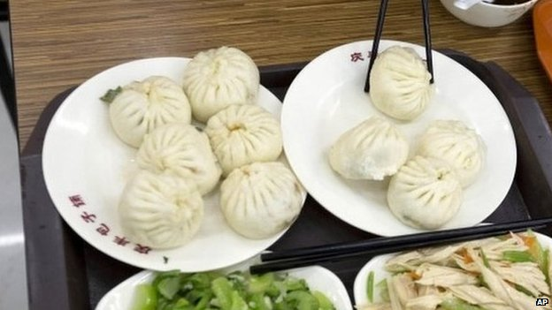 An order of food similar to what Chinese President Xi Jinping ate a day before is seen on a table after it was ordered by tourists from Guangdong province at the Qing-Feng Steamed Dumpling Shop in Beijing, China, 29 December 2013