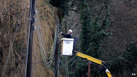 A workman repairing electricity lines near Reigate in Surrey after floods hit the area