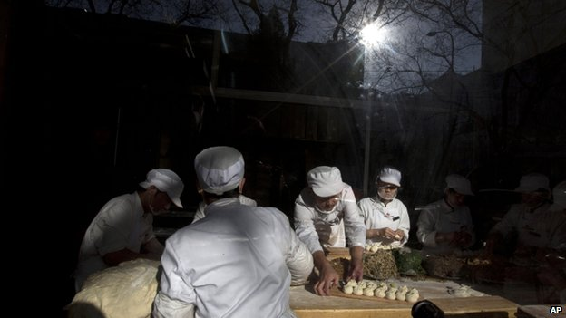 Workers make buns at the Qing-Feng Steamed Dumpling Shop where Chinese President Xi Jinping visited a day before in Beijing, China, Sunday, 29 December 2013