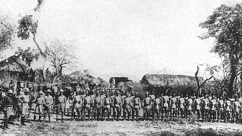 Commanding officers of the Rhodesian volunteers, B.S.A. (British South Africa) Police, with escorts of native troops in the centre