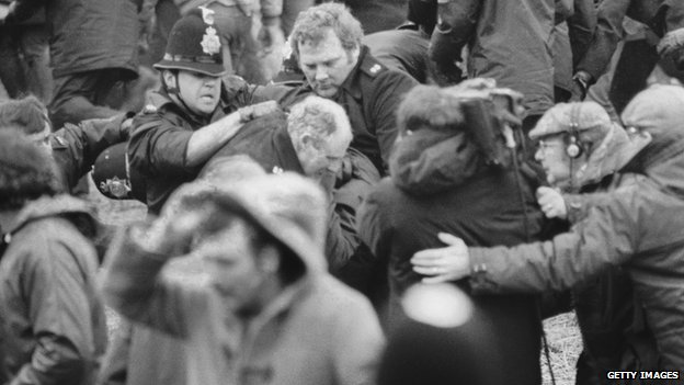 A camera crew films a scuffle between police and miners at a demonstration at Orgreave Colliery, South Yorkshire, during the miner's strike, 1984.
