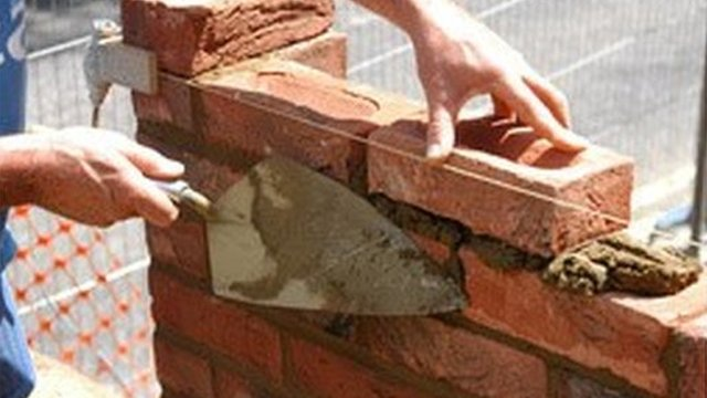 Man building with bricks