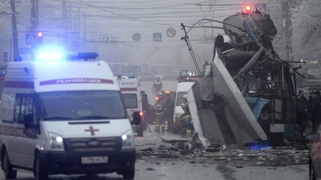 Members of the emergency services work at the site of a bomb blast on a trolleybus in Volgograd, Russia