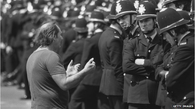 Picket talking to policemen during miners strike of 1984