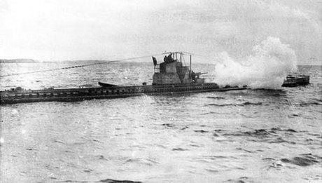 A British submarine in action, firing its gun