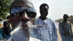 A man in Ansongo in Mali smoking cigarettes - Tuesday 29 January 2013