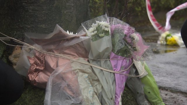 Flowers left at scene where woman died