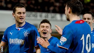 Nicky Clark (right) celebrates apologetically with Jon Daly (left) after nodding in the Irishman's header on the line.