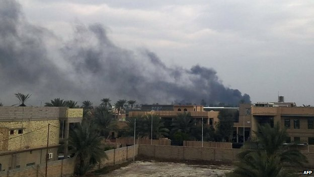 Smoke billows from the Iraqi city of Ramadi, during clashes between security forces and anti-government protesters