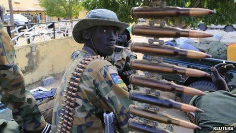 A South Sudan army soldier stands next to a machine gun mounted on a truck in Malakal town, 497km (308 miles) northeast of capital Juba