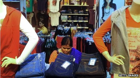 A woman browsing jeans in a shop in India