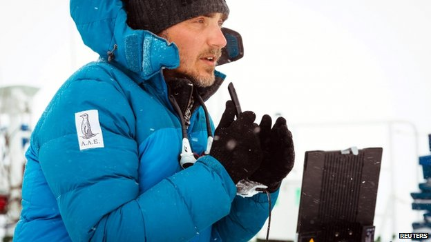 Professor Chris Turney, leader of the Australasian Antarctic Expedition, is pictured talking to international media from the top deck of the stranded