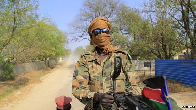 A South Sudan army soldier mans a machine gun - 30 December 2013
