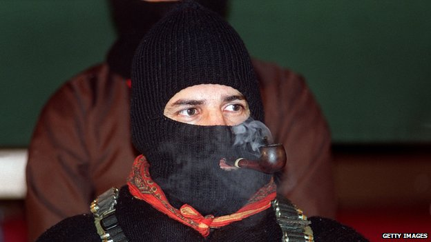 Zapatista National Liberation Army leader Subcomandante Marcos smokes a pipe during peace talks on 24 February, 1994, in San Cristobal, Mexico
